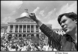 Thumbnail of Kent State Shooting Demonstration at the Boston State House: protestors gathered on the State House steps and lawn, man raising fist in foregound