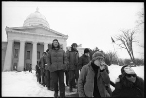 Thumbnail of Protesters descending the steps at the Vermont State House during a             demonstration against the invasion of Laos Group includes Marty Jezer (center left)