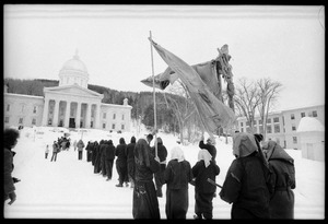 Thumbnail of Protesters from Bread and Puppet Theater, dressed in cloaks and masks, unfurl a             banner or puppet during a demonstration against the invasion of Laos at the Vermont State House