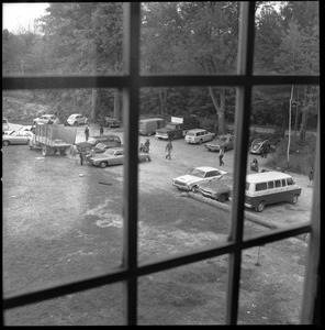Thumbnail of View out the upper window of automobiles parked in front of the Brotherhood of the Spirit commune house in             Warwick, Mass.