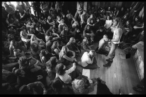 Thumbnail of Michael Metelica addressing a crowd of commune members at a meeting inside the Brotherhood             of the Spirit dormitory, Warwick, Mass.
