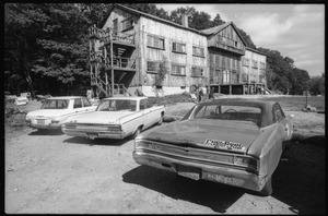 Thumbnail of View over parked cars of the Warwick dormitory, Brotherhood of the Spirit commune