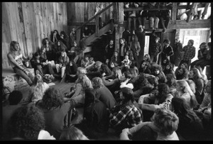 Thumbnail of Michael Metelica addressing a crowd of commune members at a meeting inside the Brotherhood             of the Spirit dormitory, Warwick, Mass. (view from left in audience)