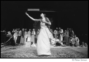 Thumbnail of Woman dancing on stage at the Kohoutek Festival of Consciousness, with             unidentified musicians