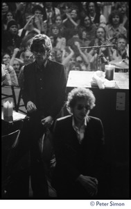 Thumbnail of Bob Dylan walking on stage at the Boston Garden, followed by Robbie       Robertson
