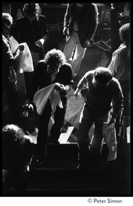 Thumbnail of Bob Dylan walking on stage at the Boston Garden