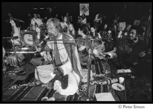 Thumbnail of Amazing Grace (band) performing at Winterland Ballroom, at a Ram Dass gathering Bhagavan Das (guitar) and Govind (far right)
