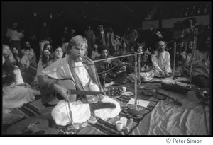 Thumbnail of Amazing Grace (band) performing at Winterland Ballroom, at a Ram Dass gathering Bhagavan Das (guitar), withGovind (violin) and Ram Dass in background