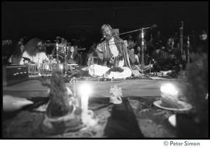 Thumbnail of Bhagavan Das playing guitar and singing with Amazing Grace (band) at the Ram             Dass gathering, Winterland Ballroom Gangadhar (tablas) in background