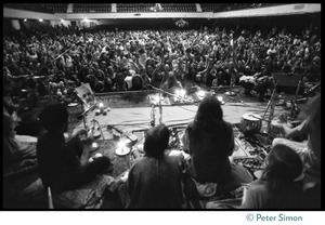 Thumbnail of View from the stage of massive audience in the Winterland Ballroom during the       Ram Dass 'marathon,' looking over the band Amazing Grace