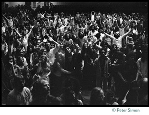Thumbnail of Audience in the Winterland Ballroom raising their arms in ecstasy, listening to Amazing Grace during the Ram       Dass 'marathon'