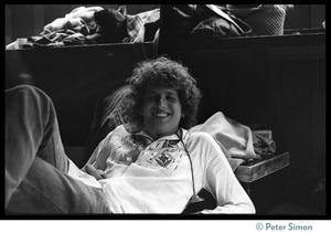 Thumbnail of Peter Simon lounging around during the Ram Dass 'marathon' at the Winterland Ballroom