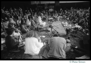 Thumbnail of Bhagavan Das onstage in the Winterland Ballroom during the Ram Dass 'marathon,'       with Amazing Grace