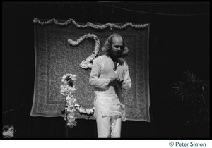 Thumbnail of Unidentified man bowing to the audience during Ram Dass' appearance at President       Theodore Roosevelt High School