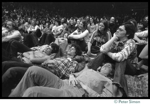 Thumbnail of Raputurous audience members packed onto the floor, several lying down, during an appearance by Ram Dass at the College of Marin