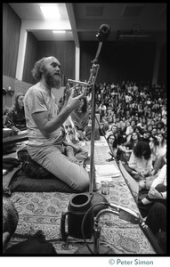 Thumbnail of Ram Dass on stage during an appearance at the College of Marin