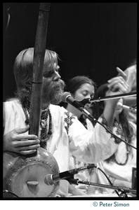 Thumbnail of Bhagavan Das on stage with dotara, singing with Amazing Grace, at Zellerbach Hall, U.C. Berkeley