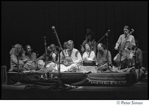 Thumbnail of Amazing Grace performing at Zellerbach Hall, U.C. Berkeley, with Allen Ginsberg From left: Gangadhar, Krishna Das, unidentifed, Ram Dev, Bhagavan Das, Azima, Alen Ginsberg,             unidentified (2)
