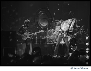 Thumbnail of John Paul jones (bass), John Bonham (drums), Robert Plant (vocals), and Jimmy Page (guitar) in             concert with Led Zeppelin at the Forum in Inglewood