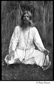 Thumbnail of Bhagavan Das: full length portrait seated in a lotus position, facing the camera