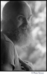 Thumbnail of Ram Dass: half-length portrait in a tee-shirt while at the Rowe Center spiritual retreat