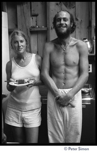 Thumbnail of Two attendees standing in the kitchen, eating lunch, Rowe Center spiritual retreat