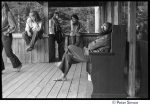 Thumbnail of Attendees seated on the porch, Rowe Center spiritual retreat