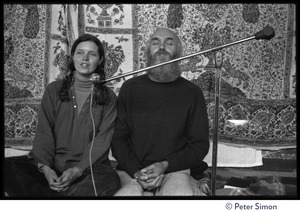 Thumbnail of Ram Dass and woman on stage at the Rowe Center spiritual retreat