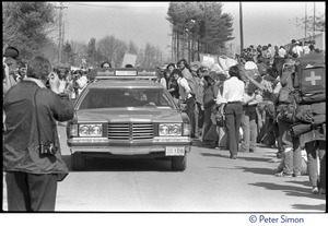 Thumbnail of Plant security patrol car driving through a crowd of occupiers during the occupation of the Seabrook Nuclear Power Plant