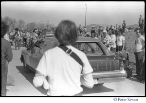 Thumbnail of State police vehicle, with police dog, driving past occupiers during the occupation of the Seabrook Nuclear Power Plant