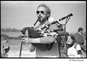 Thumbnail of Bagpiper leading a band of occupiers during the occupation of Seabrook Nuclear Power Plant Close-up of the piper