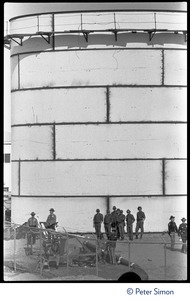 Thumbnail of State police gathered behind a chain link fence, during the occupation of Seabrook Nuclear Power Plant