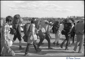 Thumbnail of Occupiers with backpacks and water jugs marching to join the occupation of Seabrook Nuclear Power Plant