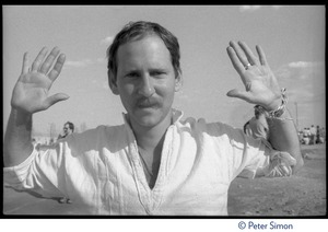 Thumbnail of Unidentified occupier with hands up, during the occupation of the Seabrook Nuclear Power Plant