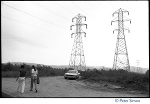 Thumbnail of Car parked on a dirt road by high voltage power transmission towers, near the Alternative Energy Coalition antinuclear demonstration on Montague             Plain