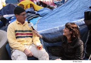 Thumbnail of Occupy Wall Street: reporter from the Wall Street Journal interviewing demonstrator