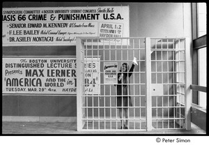 Thumbnail of Woman posing in cell, waving a handkerchief