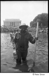 Thumbnail of Unidentified protestor wading in a Mall reflecting pool during the Poor People's Campaign Solidarity Day
