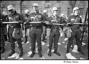 Thumbnail of Members of the Civil Disturbance Unit lined up with batons