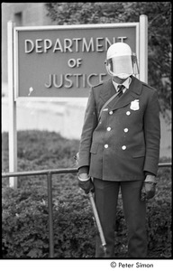Thumbnail of Member of the Civil Disturbance Unit in front of the Department of Justice