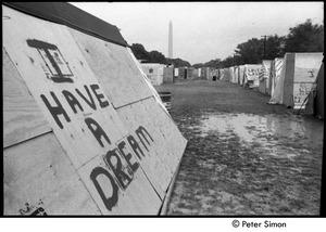 Thumbnail of Plywood 'tent' with 'I have a dream' spray-painted on the side and the Washington Monument in the distance, Resurrection City