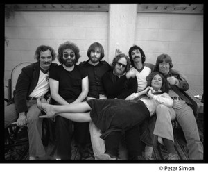Thumbnail of Grateful Dead group shot Left to right: Bill Kreutzman,Jerry Garcia,  Bob Weir, Keith Godchaux, Mickey             Hart, and Phil Lesh, with Donna Jean Godchaux stretched across their laps