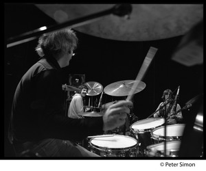 Thumbnail of Bill Kreutzman (Grateful Dead) playing drums in concert Mickey Hart and Phil Lesh visible in background
