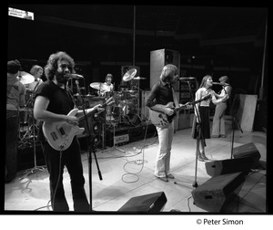 Thumbnail of Grateful Dead performing on stage Left to right (front): Jerry Garcia,  Bob Weir, Donna Jean Godchaux, and Phil Lesh; Bill Kreutzman             and Mickey Hart on drums in rear