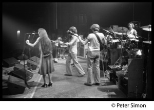 Thumbnail of Grateful Dead on stage Left to right: Donna Godchaux, Bob Weir, Phil Lesh, Michkey Hart