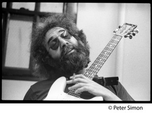 Thumbnail of Jerry Garcia: portrait with guitar and cigarette