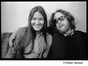 Thumbnail of Keith Godchaux, seated on a couch with arm around Donna Godchaux