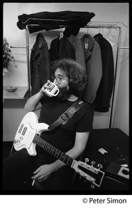Thumbnail of Jerry Garcia: half-length portrait seated, with a cup of coffee