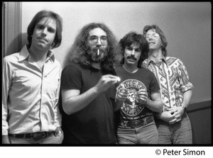 Thumbnail of Grateful Dead backstage (left to right): Bob Weir, Jerry Garcia, Mickey Hart, and Phil             Lesh