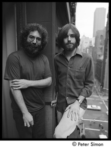 Thumbnail of Jerry Garcia (left) and Bob Weir of the Grateful Dead standing on a balcony